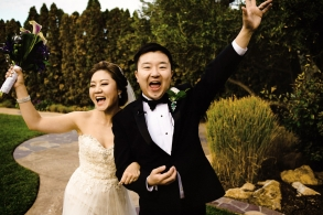 A newly happily celebrates as they walk off their Wedding Ceremony